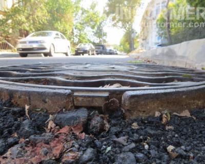 Жизни севастопольских автомобилистов угрожают выступающие люки! (МНОГО ФОТО)