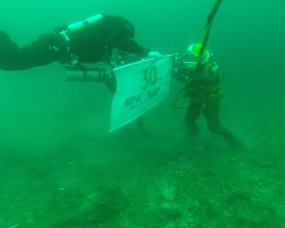 Флаг с символикой «30 лет МЧС России» установлен водолазами в самой южной точке Крыма